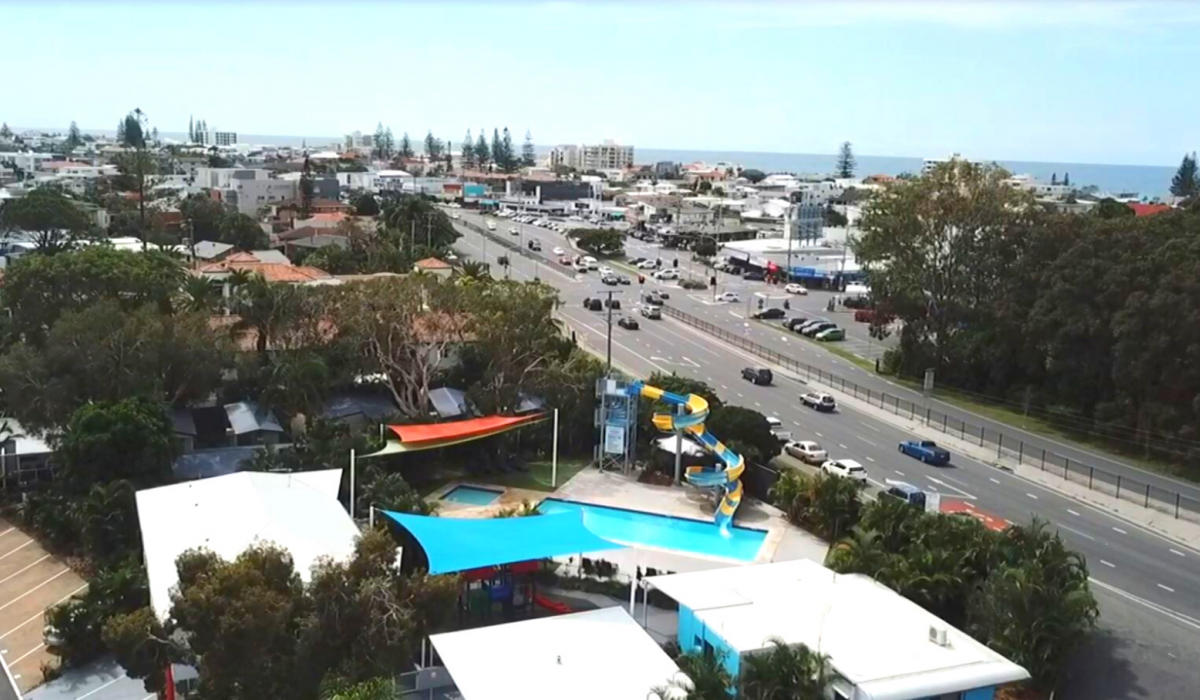 Across the road from the Nobby Beach Cafe & Dining Precinct
