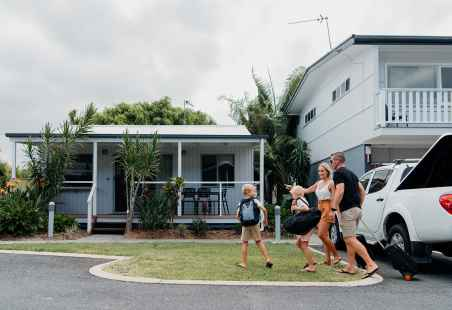 Family holidaying in a Deluxe Tropical Villa at Nobby Beach Holiday Village
