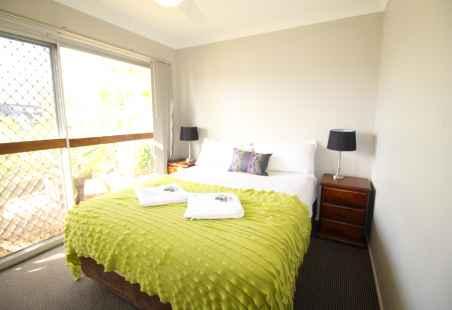 Main Bedroom of Garden House at Nobby Beach Holiday Village