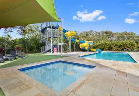 Pool area with two heated pools and 35m waterslide