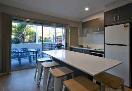 Poolside Penthouse Modern Kitchen with benchtop island