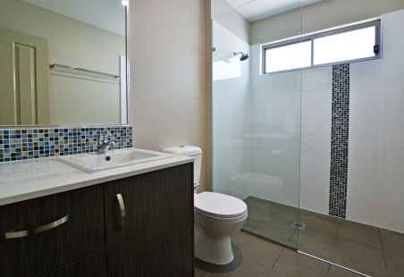 Poolside Penthouse Bathroom with walk in shower